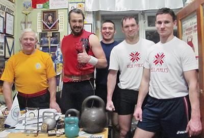 Президент Международной федерации гиревого спорта Юрий Щербина (слева), Андрей Цыков и Дмитрий Коренкович (крайние справа)